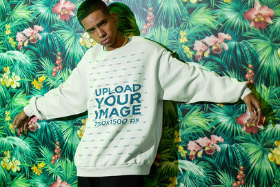 Sweatshirt Mockup of a Man Posing in Front of a Tropical-Themed Mural m571