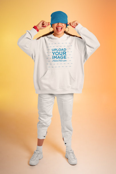 Oversize Hoodie Mockup of a Cheerful Woman with Her Tongue Out m638