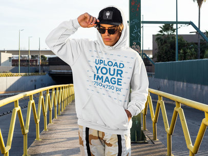 Mockup of a Man Wearing a Pullover Hoodie on the Street m524