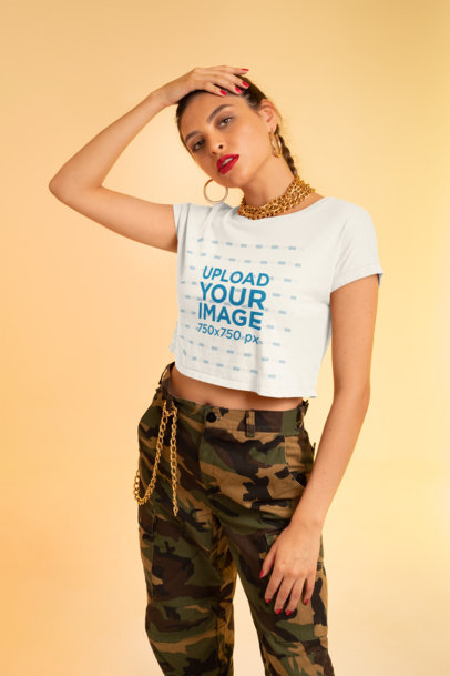 Mockup of a Fashionable Woman Posing with a Crop Top In a Studio M642