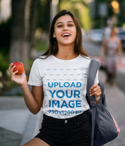 Tee Mockup of a Young Female Student Laughing 45021-r-el2