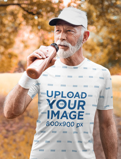 Sublimated Tee Mockup Featuring a Senior Man Drinking Water 45298-r-el2