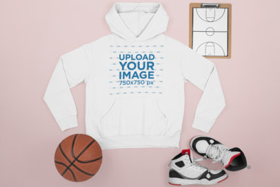 Mockup of a Flat-Laid Hoodie Next to Basketball Items M655