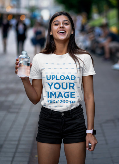 Tee Mockup of a Joyful Woman Holding a Glass of Water 45420-r-el2