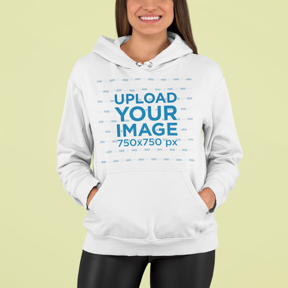 Mockup of a Happy Woman Posing with a Hoodie in a Studio m762