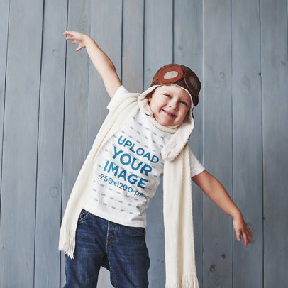 T-Shirt Mockup of a Happy Kid Wearing an Aviator Hat and Goggles 43101-r-el2