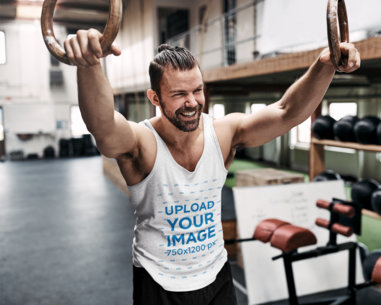 Tank Top Mockup of a Muscular Man Doing a Rings Workout 41195-r-el2