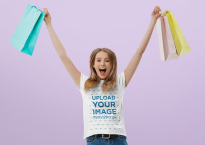 T-Shirt Mockup of an Excited Woman with Shopping Bags 45542-r-el2