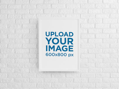 Mockup of a Framed Art Print Hanging on a Brick Wall m964