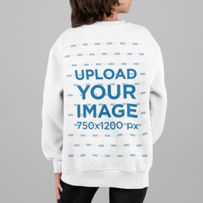Back View Sweatshirt Mockup Featuring a Kid at a Studio m866