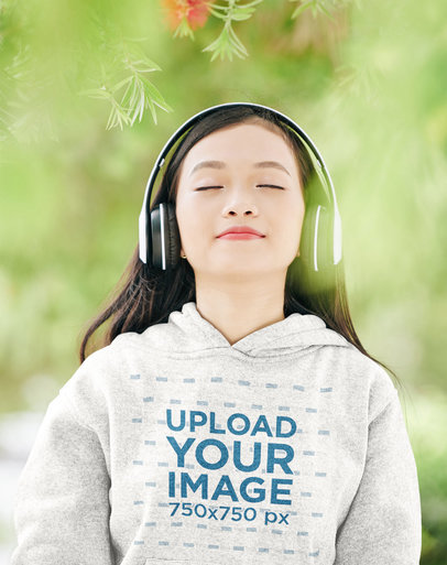 Hoodie Mockup of a Woman Relaxing Listening to Music 45156-r-el2