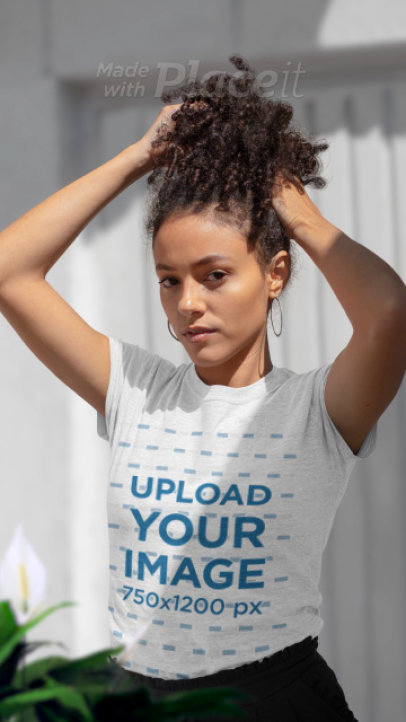 Parallax Video of a Curly-Haired Woman Wearing a T-Shirt 2517