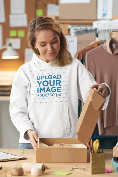Pullover Hoodie Mockup Featuring a Young Woman Packing Some Products 45521-r-el2