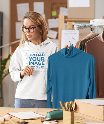 Hoodie Mockup of a Young Woman Working at a Fashion Studio 45666-r-el2