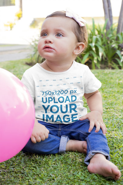 T-Shirt Mockup Featuring a Baby Girl Sitting on the Grass m935