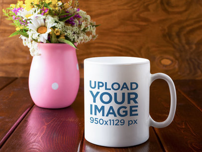 11 oz Coffee Mug Mockup Featuring a Flower Vase and a Wooden Table 45004-r-el2