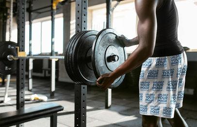Shorts Mockup of a Man at the Gym Loading a Barbell 34898-r-el2