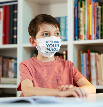 Face Mask Mockup of a Little Kid in a School Library 46120-r-el2