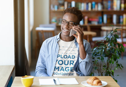 T-Shirt Mockup of a Young Man Making a Call While Studying 46130-r-el2