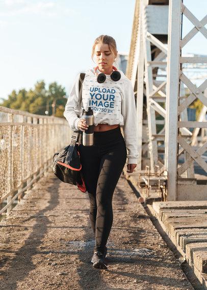 Crop Top Hoodie Mockup Featuring a Woman Walking to the Gym 46192-r-el2