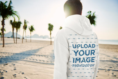 Back-View Hoodie Mockup of a Man Walking on the Beach 46426-r-el2