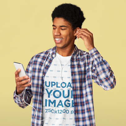 T-Shirt Mockup of a Young Man Listening to Music in a Studio 46085-r-el2
