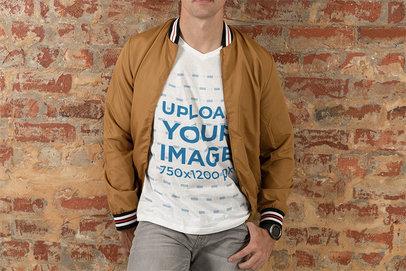 V-Neck T-Shirt Mockup of a Young Man Posing Against a Brick Wall 46530-r-el2