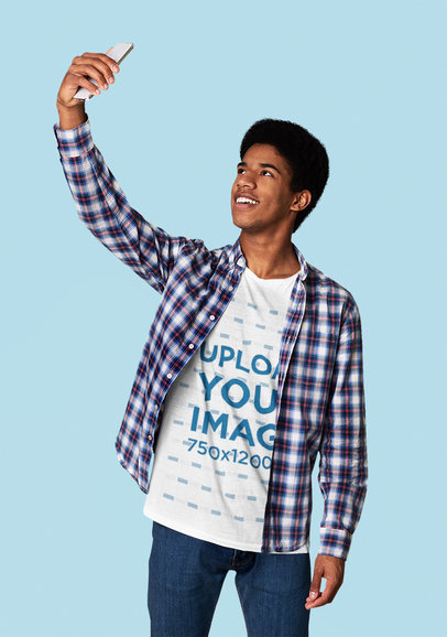 T-Shirt Mockup of a Young Man Taking a Selfie at a Studio 46083-r-el2