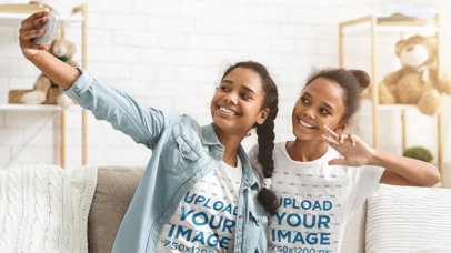 Mockup of Two Sisters Taking a Selfie While Wearing T-Shirts 46093-r-el2