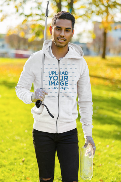 Full-Zip Hoodie Mockup Featuring a Young Man Cleaning a Park 46536-r-el2