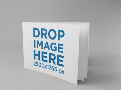 Horizontal Booklet Mockup Standing on a Solid Surface a15090