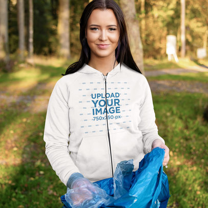 Mockup of a Woman Wearing a Full-Zip Hoodie While Cleaning a Park 46219-r-el2