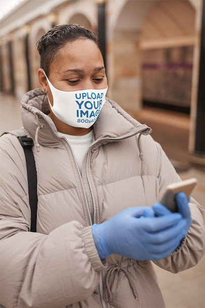 Face Mask Mockup of a Woman Using Her Phone on the Street 46660-r-el2