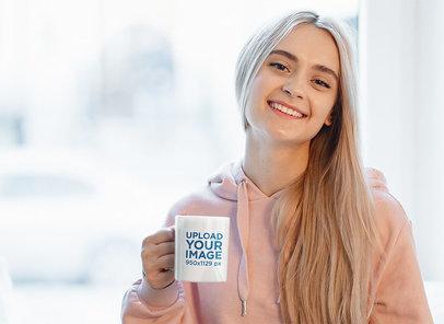 Mockup of a Blonde Woman Holding an 11 oz Mug 46820-r-el2