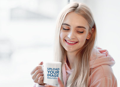 Mockup of a Happy Young Woman Holding an 11 oz Coffee Mug 46818-r-el2
