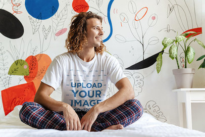 T-Shirt Mockup of a Long-Haired Man Sitting on His Bed 46566-r-el2