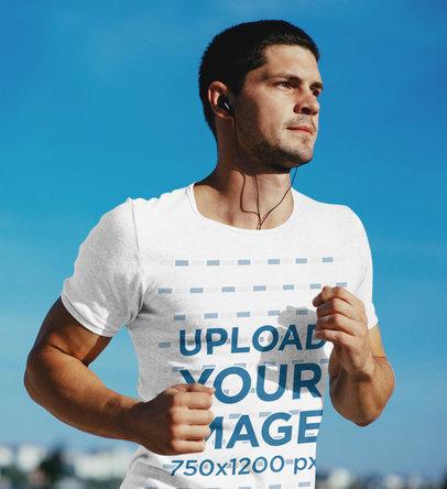 Tee Mockup of a Man with Earphones Jogging Outdoors 43476-r-el2
