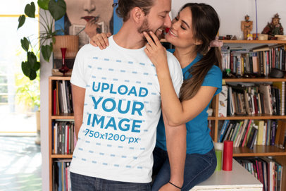 T-Shirt Mockup of a Happy Couple Posing in Their Home Library m1113