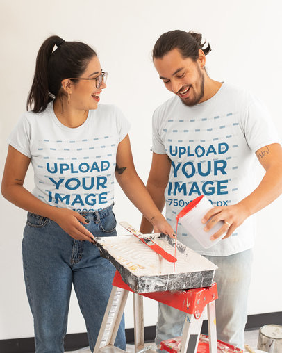 T-Shirt Mockup of a Couple Having Fun with Paint m1083