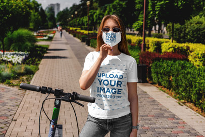 T-Shirt and Face Mask Mockup Featuring a Woman with a Scooter 5003-el1