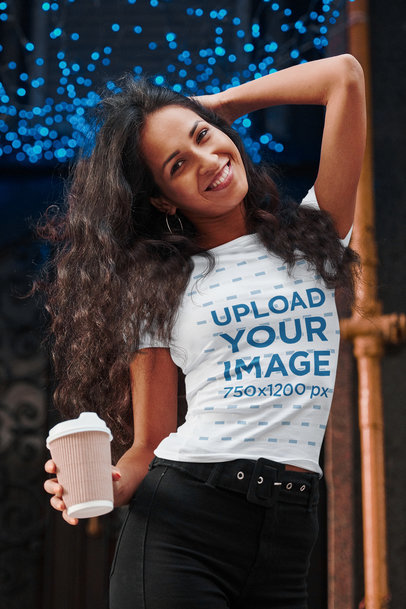 T-Shirt Mockup of a Happy Woman Posing Outside of a Trendy Coffee Shop 44735-r-el2