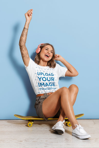 T-Shirt Mockup Featuring a Woman Listening to Music on a Skateboard 46311-r-el2