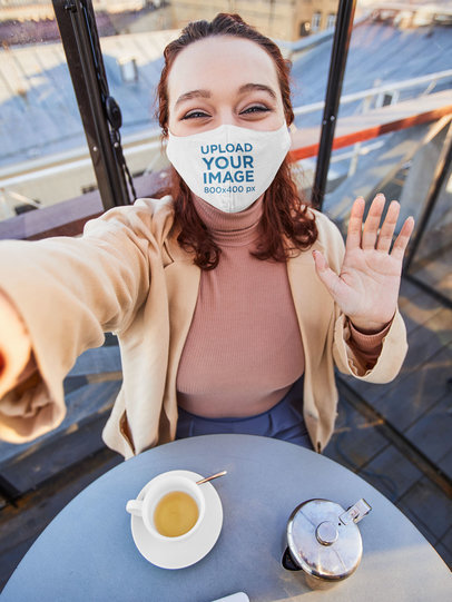 Face Mask Mockup of a Woman Taking a Selfie in a Coffee Shop 46801-r-el2