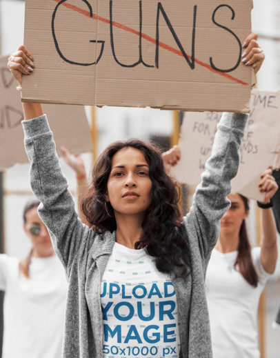 T-Shirt Mockup Featuring a Woman at a Protest with an Anti-Gun Sign 46754-r-el2