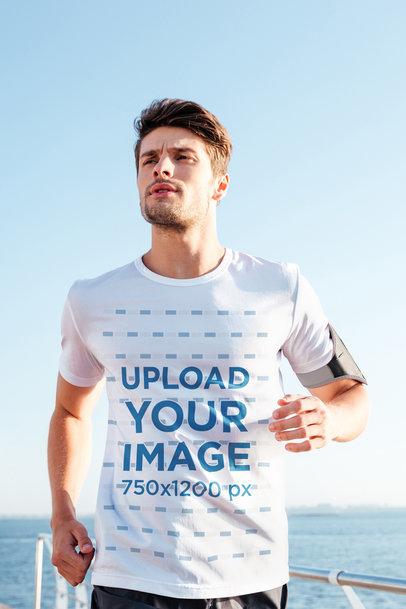 T-Shirt Mockup of a Man Jogging by the Sea 42742-r-el2