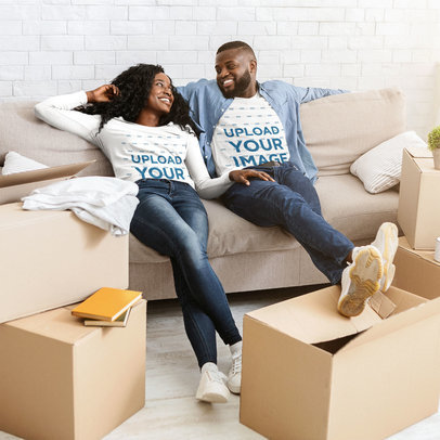 Long Sleeve Tee Mockup of a Couple Relaxing on the Couch by Moving Boxes 46101-r-el2