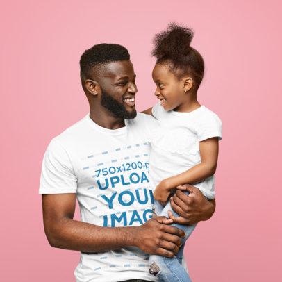 T-Shirt Mockup of a Happy Dad Carrying His Daughter at a Studio 46088-r-el2