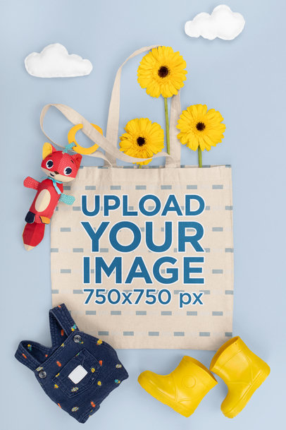 Tote Bag Mockup Featuring a Baby Outfit for a Rainy Day m1150