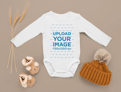 Mockup Featuring a Customizable Onesie Surrounded by Other Baby Garments m1133