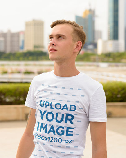T-Shirt Mockup Featuring a Blonde Man in a City 44403-r-el2